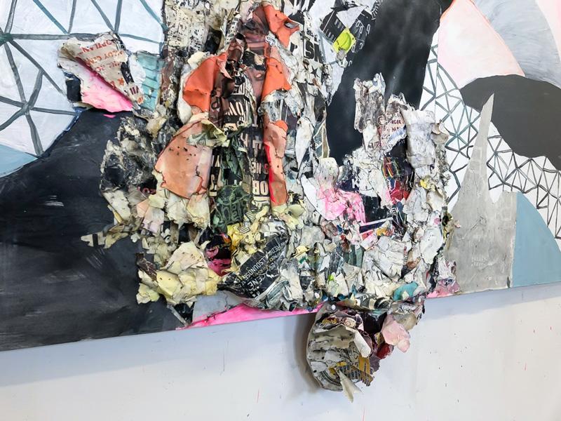 "<em>Persist - Triptych </em> (Detail) Acrylic, spray paint, found paper, plexiglas, and staples on panel, 36x108"" 2018"