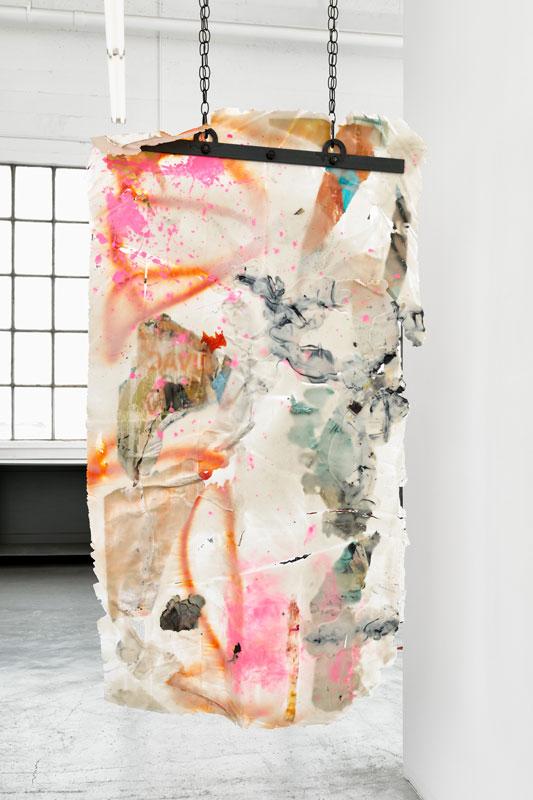 "<em>Skin 1</em> (Side B) Acrylic, found paper, spray paint, netting, staples, iron bars, bolts, chains, 96"" x 37"" 2019"
