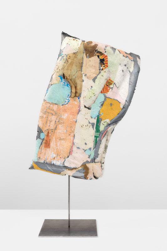 "<em>Torso</em> (Back) Plastic, foam, found paper, acrylic leather, iron 40x20x12"" 2019"