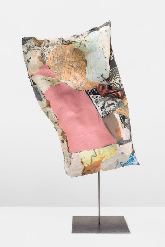 "<em>Torso</em> (Front) Plastic, foam, found paper, acrylic leather, iron 40x20x12"" 2019"